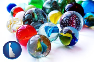 glass marbles - with Delaware icon