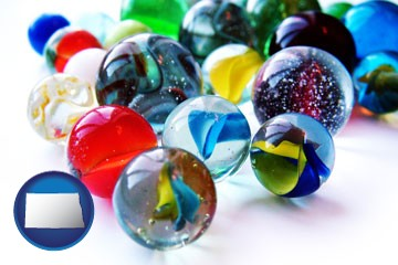 glass marbles - with North Dakota icon