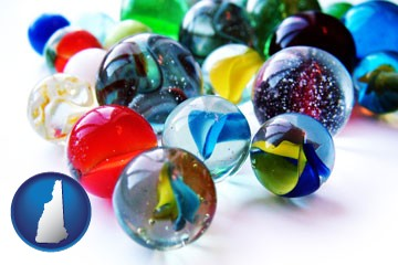 glass marbles - with New Hampshire icon